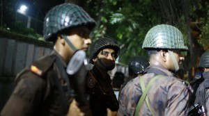 Bangladeshi security personnel stand guard near a restaurant that has reportedly been attacked by unidentified gunmen in Dhaka, Bangladesh, Friday, July 1, 2016. Local media reported that a group of attackers took hostages inside a restaurant frequented by both locals and foreigners in a diplomatic zone in Bangladesh's capital. (AP Photo)